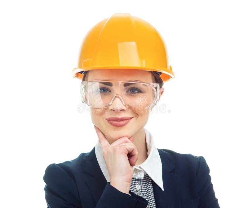 Femme d'ingénieur au-dessus du fond blanc images libres de droits