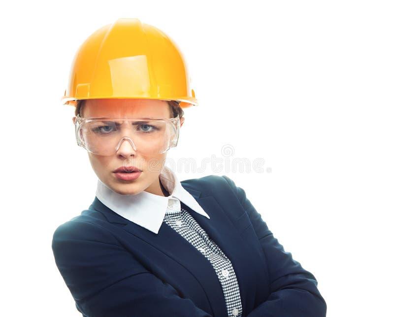 Femme d'ingénieur au-dessus du fond blanc photographie stock
