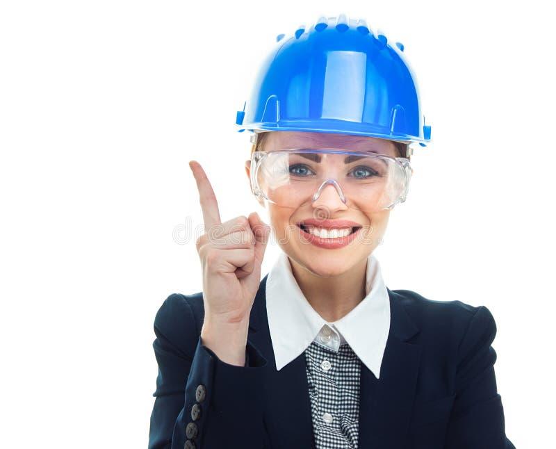 Femme d'ingénieur au-dessus du fond blanc photo stock
