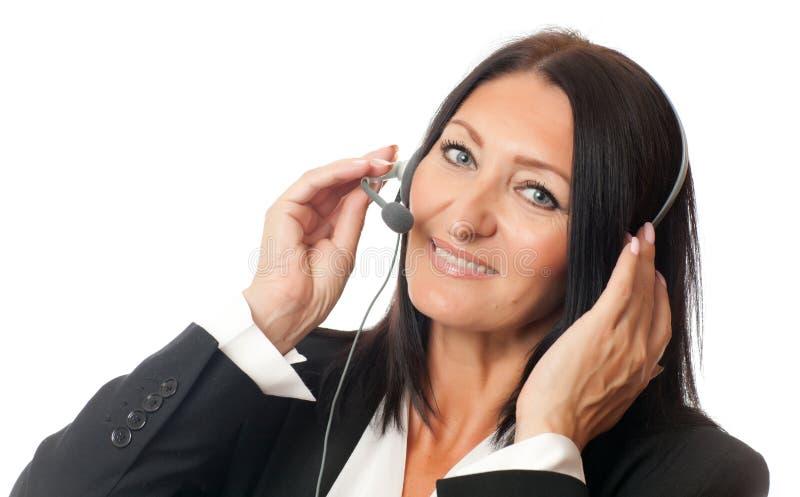 Femme dans des écouteurs photographie stock libre de droits