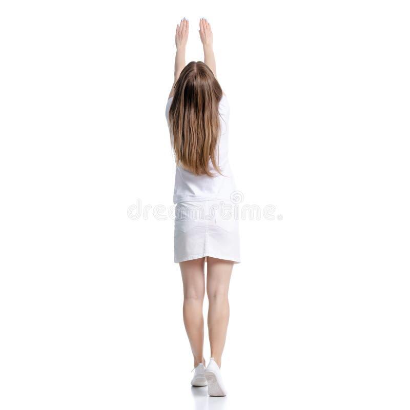 Femme dans des mains debout blanches de T-shirt et de jupe vers le haut de se tenir photo stock