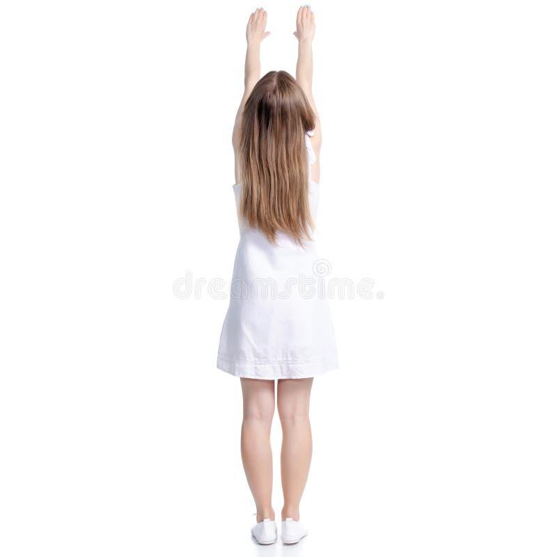 Femme dans des mains debout de robe blanche vers le haut de se tenir photo libre de droits