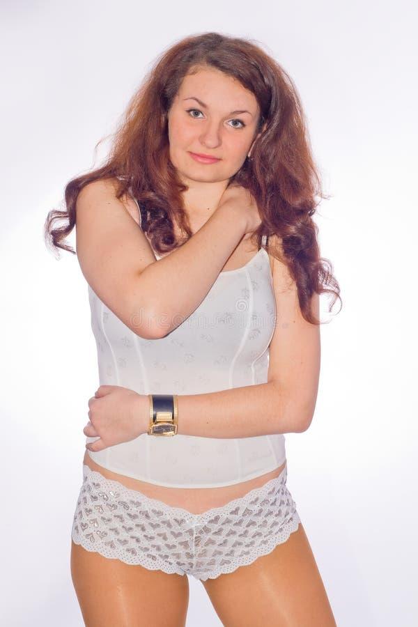Femme dans des pyjamas photographie stock libre de droits