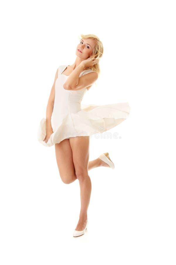 Femme dans la jupe blanche photographie stock libre de droits