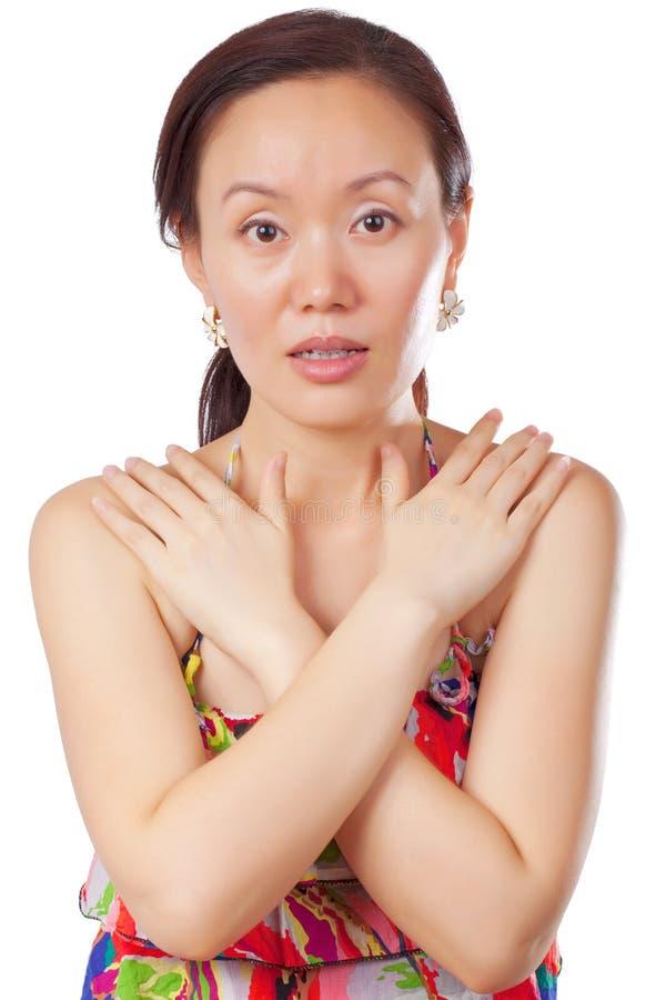 Femme dans la pose de protection photographie stock