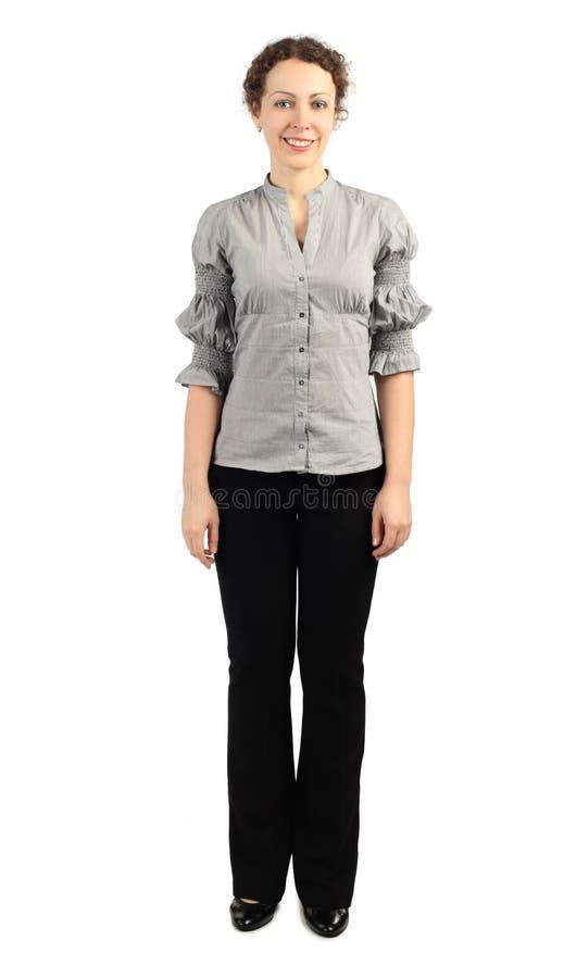 Femme dans la position et le sourire de robe d'affaires image stock