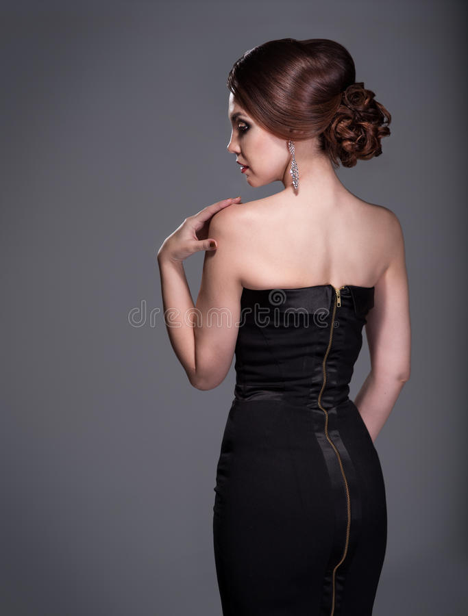 Femme dans la robe de soirée photographie stock