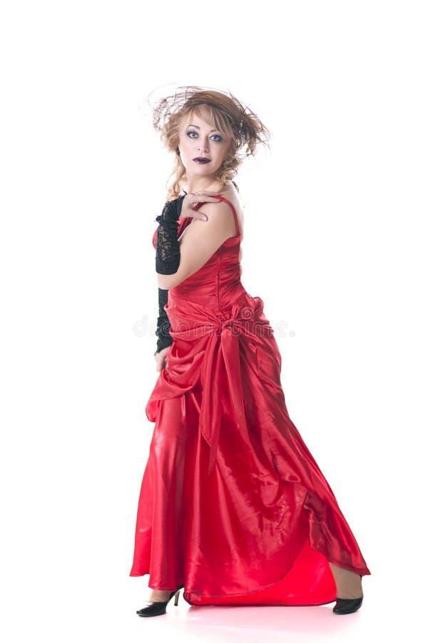Femme dans la robe et le chapeau rouges images libres de droits