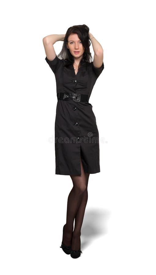 Femme dans la robe noire d'isolement sur le fond de wahite photographie stock libre de droits