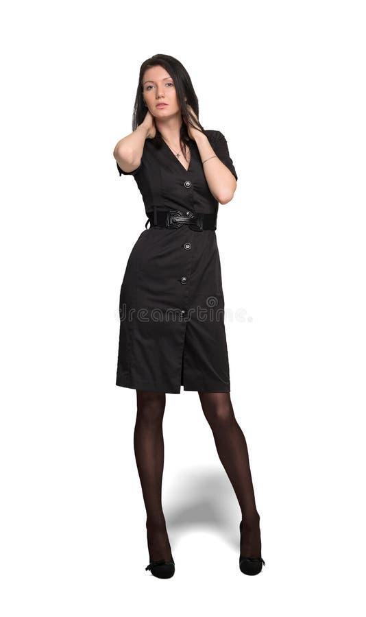 Femme dans la robe noire d'isolement sur le fond de wahite photo libre de droits