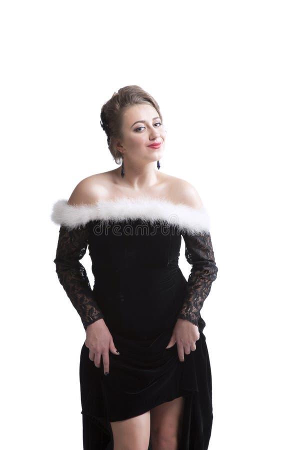 Femme dans la robe noire de vintage photos libres de droits