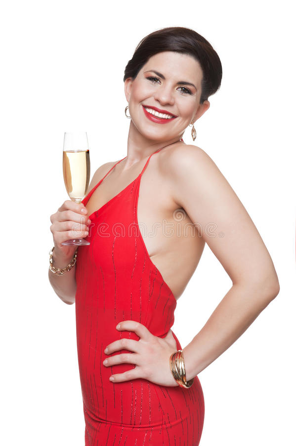 Femme dans la robe rouge avec le verre, fond blanc photographie stock libre de droits