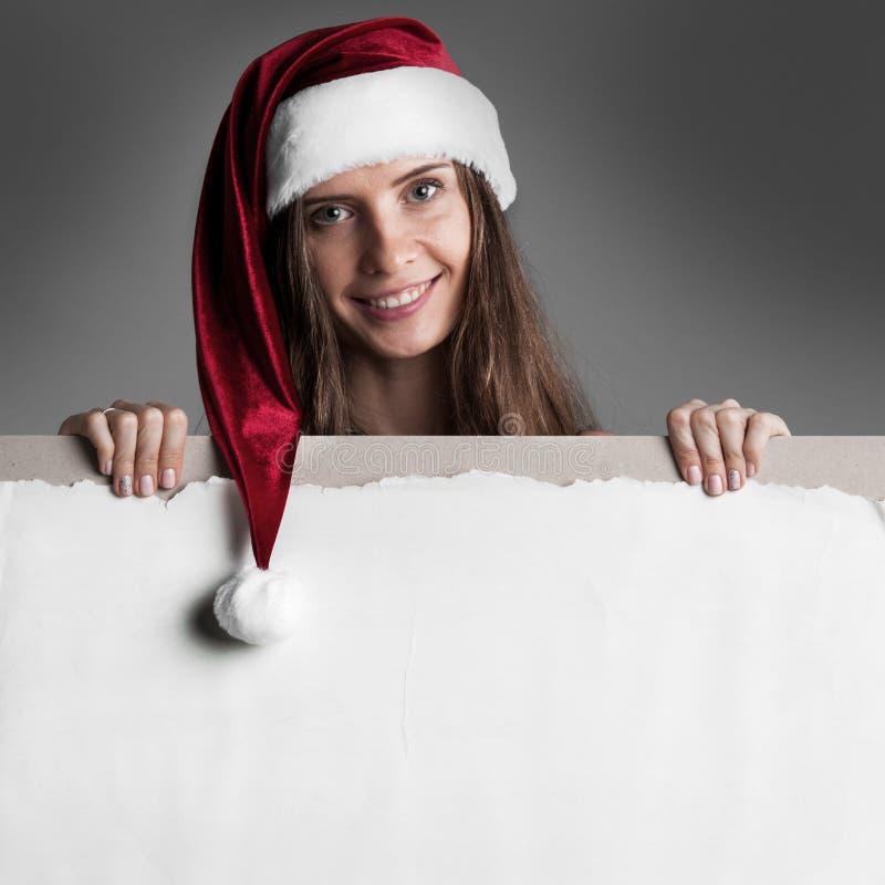 Femme dans le chapeau de Santa avec la bannière photo libre de droits