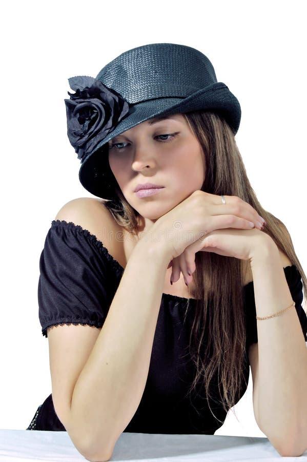 Femme dans le chapeau noir 1 photographie stock libre de droits