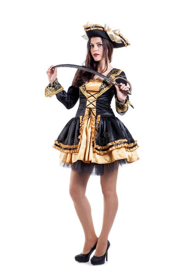 Femme dans le costume de carnaval Forme de pirate D'isolement photographie stock libre de droits