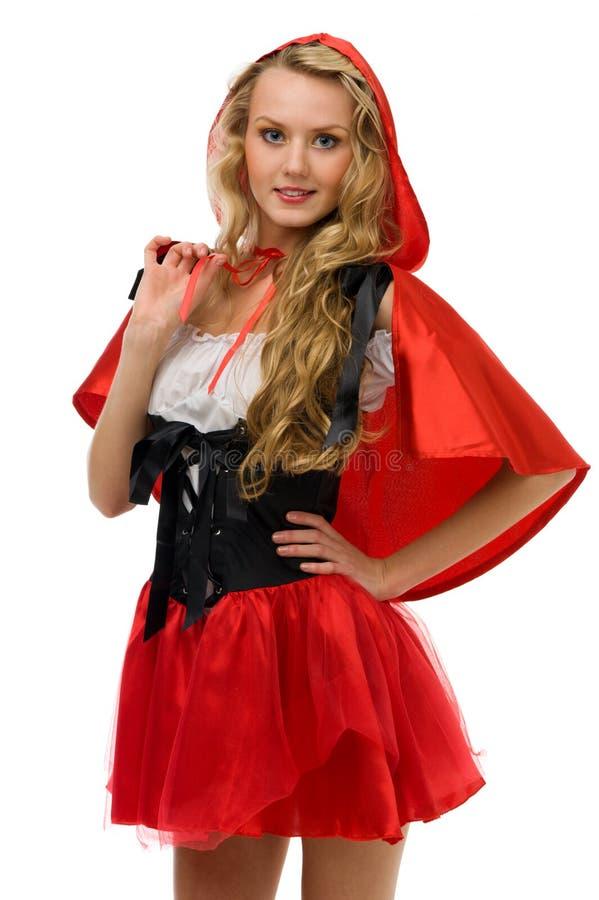 Femme dans le costume de carnaval. Peu de capot d'équitation rouge photographie stock
