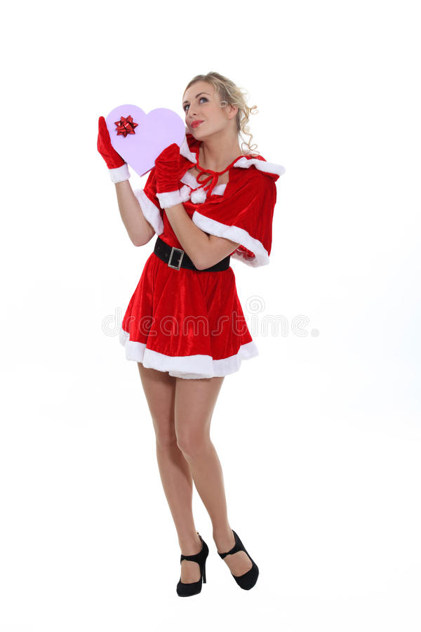 Femme dans le costume suggestif de Noël photo libre de droits