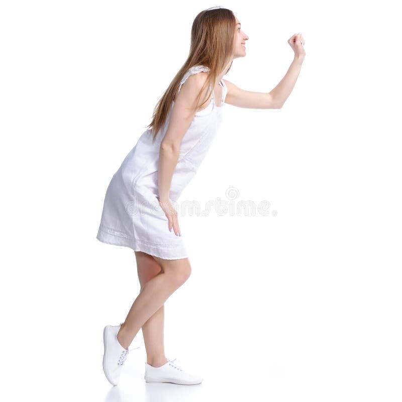 Femme dans le coup blanc de robe sur la porte images stock