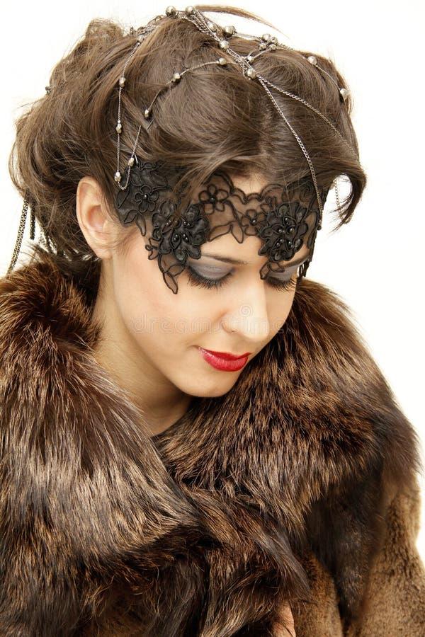 Femme dans le manteau de fourrure images stock