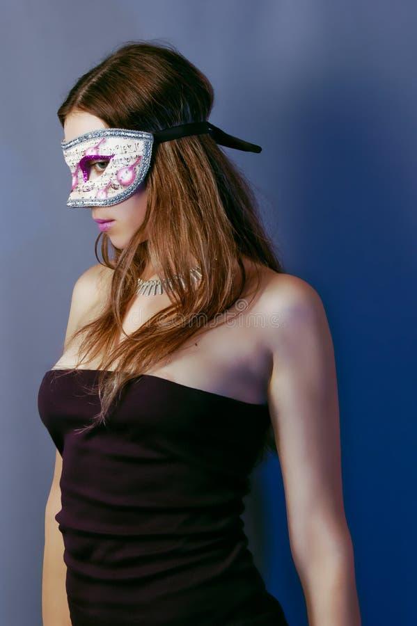 Femme dans le masque 4 images stock