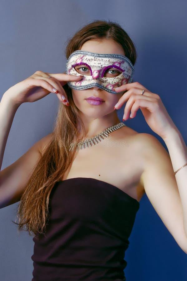 Femme dans le masque 5 images stock