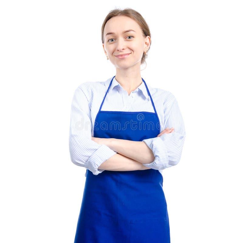 Femme dans le sourire bleu de tablier photo libre de droits