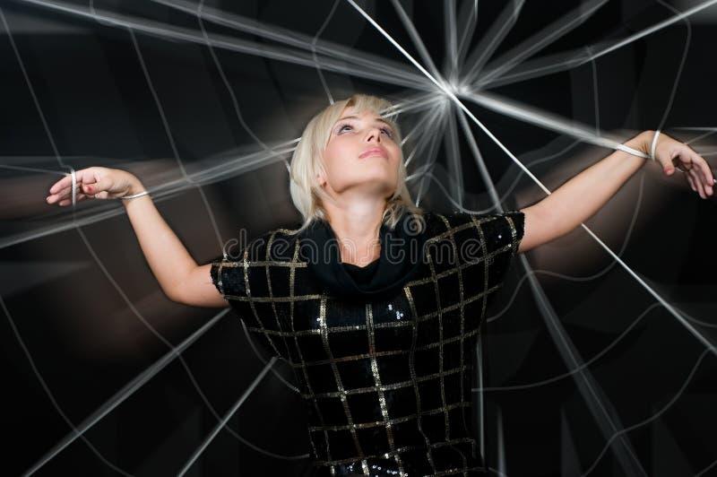 Femme dans le Web. photo stock