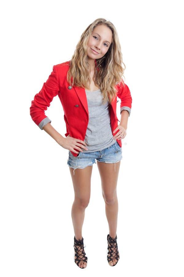Femme dans les jeans courts et la jupe rouge photos libres de droits