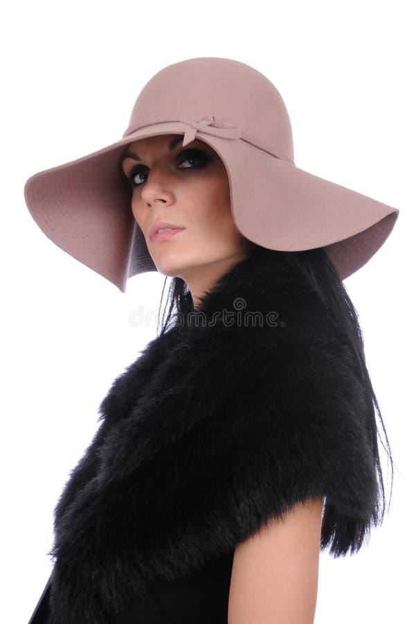 Femme dans un chapeau photographie stock