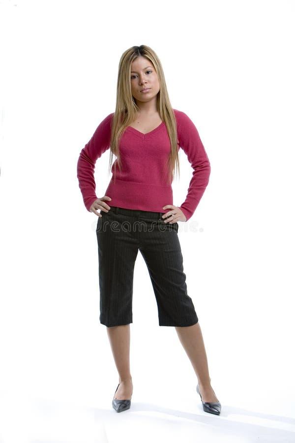 Femme dans un dessus rose photographie stock