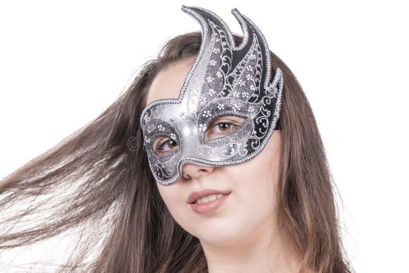 Femme dans un masque gris image stock