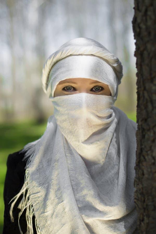 Femme dans un Niqab image stock