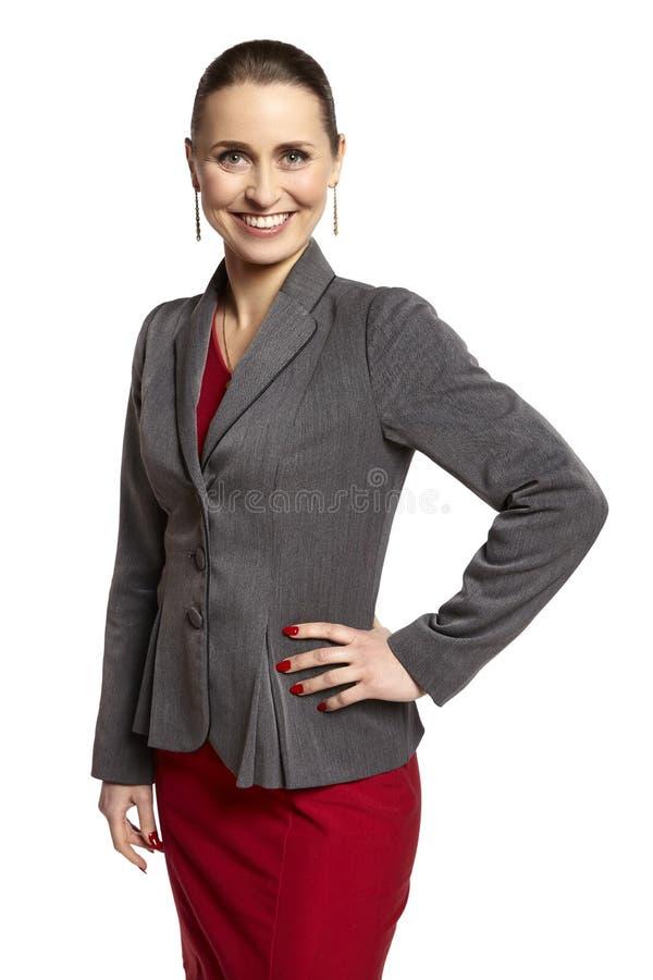 Femme dans une robe et un Gray Jacket rouges photo libre de droits