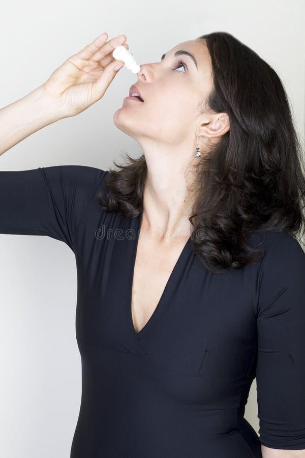 Femme de baisses de nez photos stock