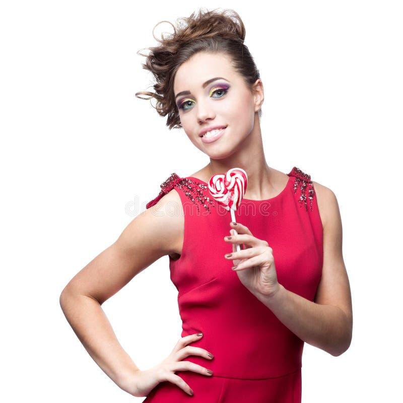 Femme de brune tenant la lucette photo libre de droits