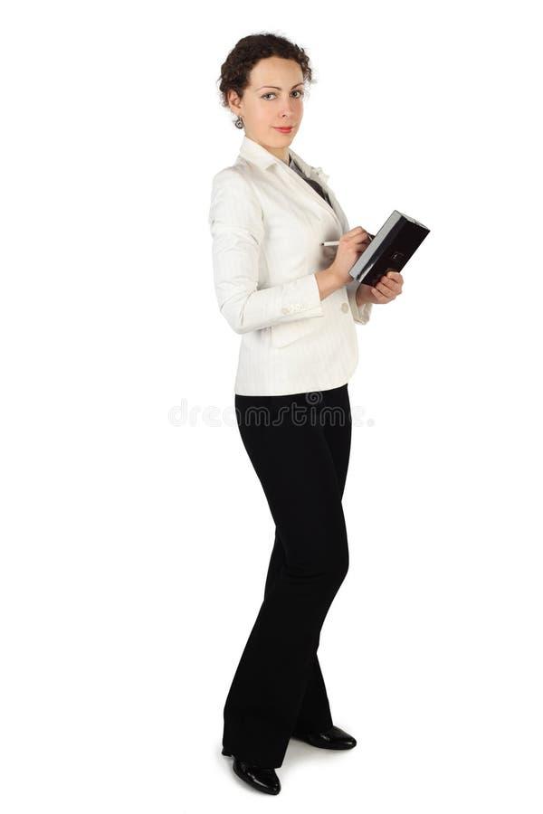 Femme de Brunette dans la robe d'affaires photo stock