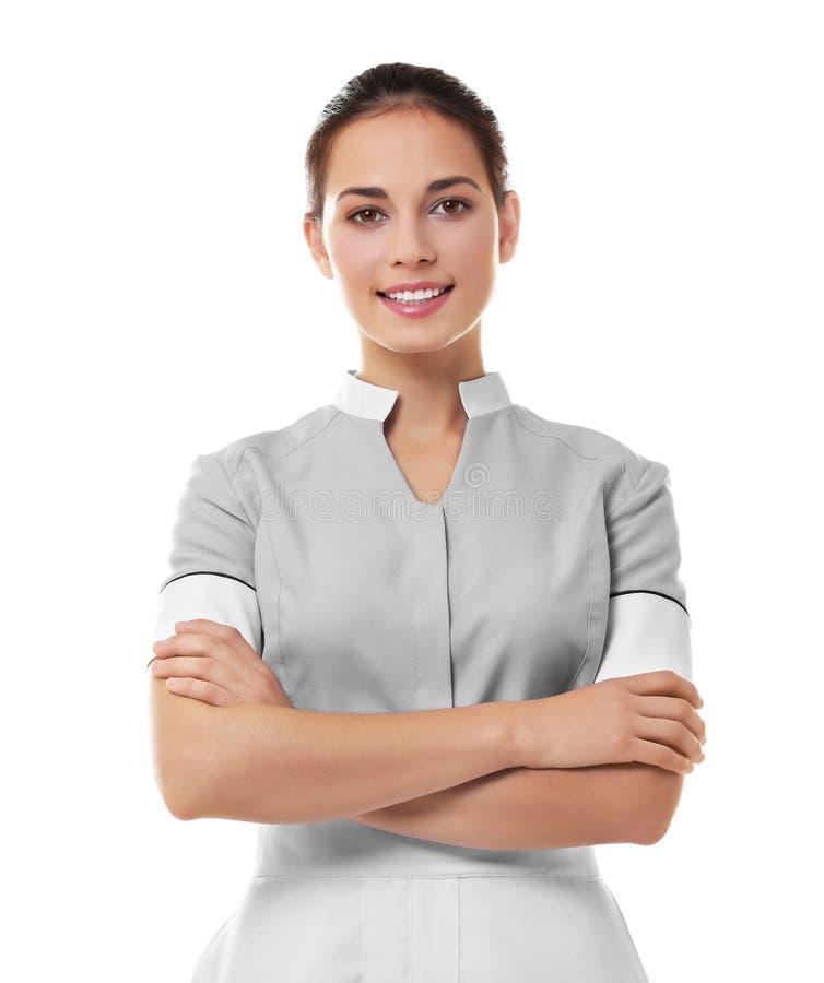 Femme de chambre féminine d'hôtel sur le fond blanc photographie stock libre de droits