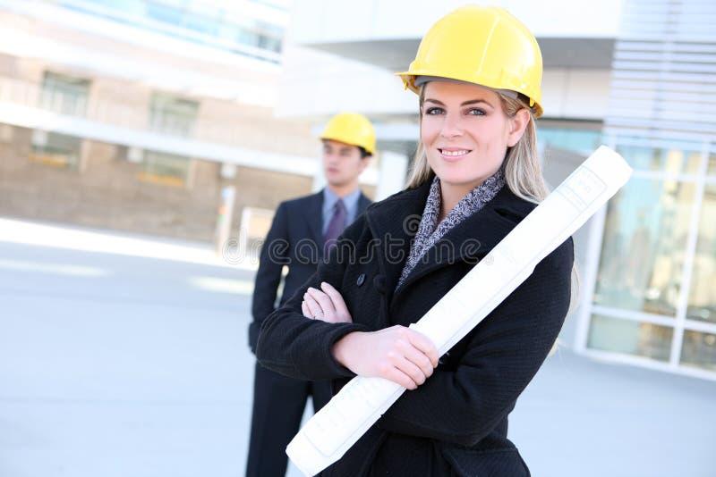 Femme de construction d'affaires photos stock