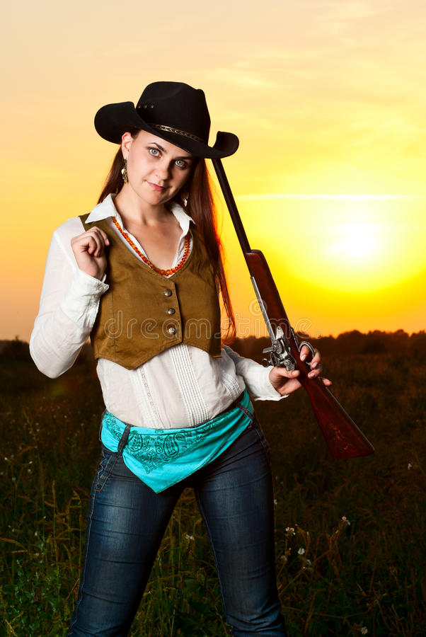 Femme de cowboy. photographie stock