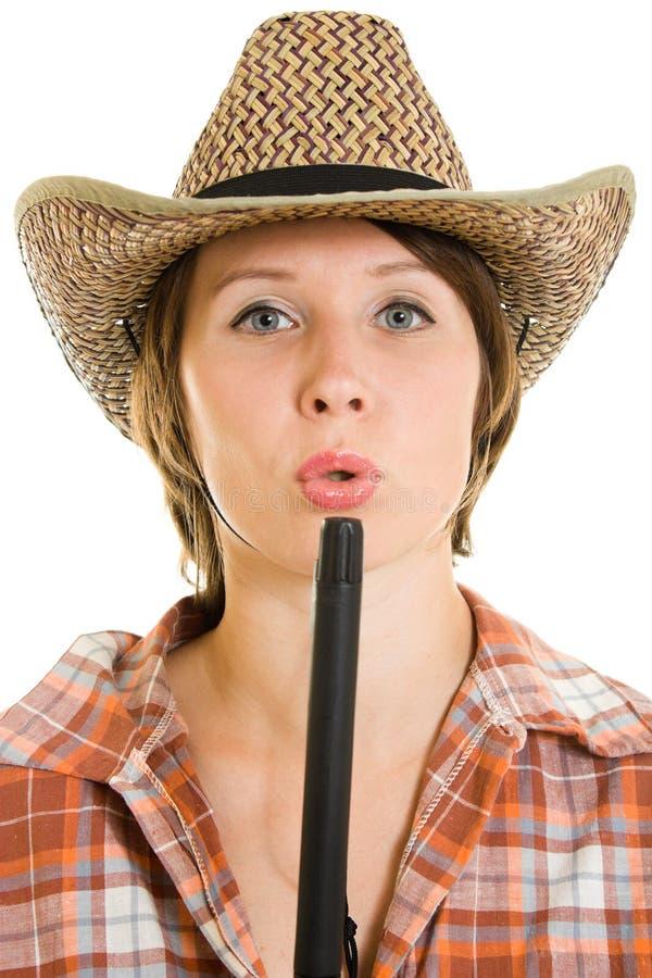 Femme de cowboy avec un canon. photo stock
