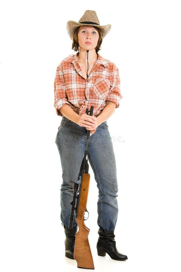 Femme de cowboy avec un canon. image stock