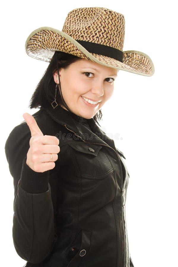 Femme de cowboy sur un fond blanc. image stock