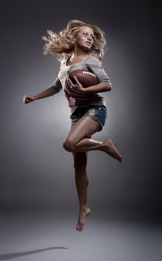Femme de football américain image stock