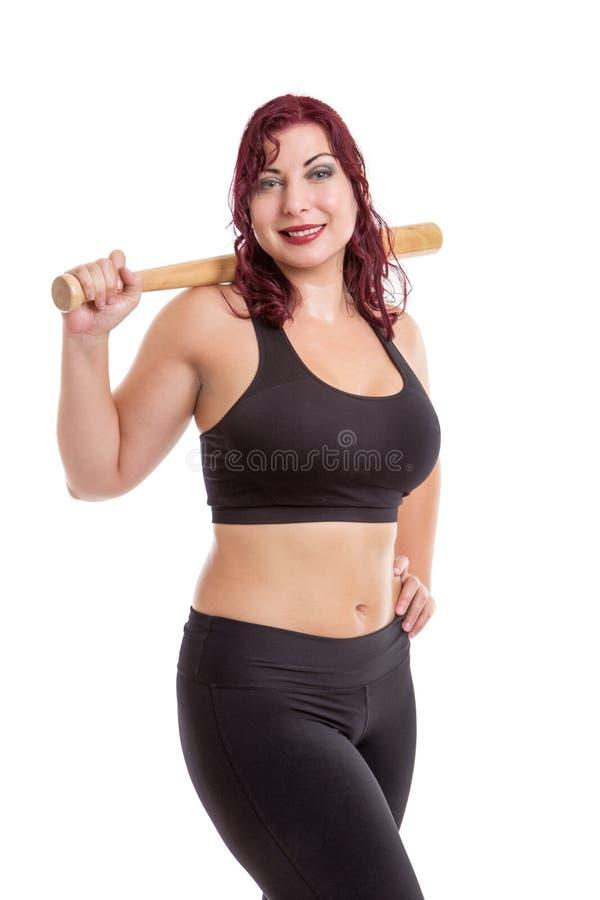 Femme de forme physique avec la batte de baseball image libre de droits
