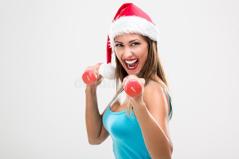 Femme de forme physique de Noël photo stock