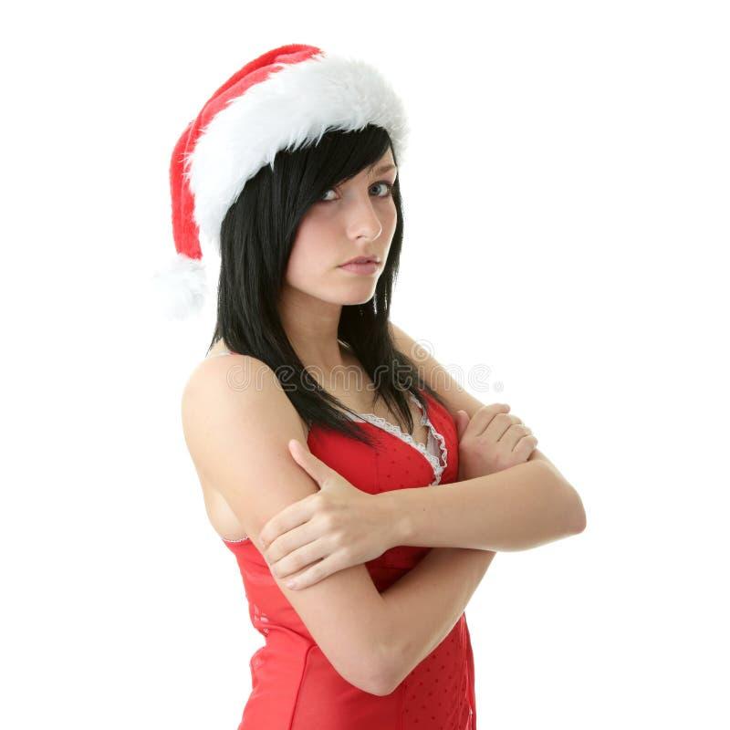 Femme de l'adolescence utilisant le chapeau de Santa photographie stock libre de droits
