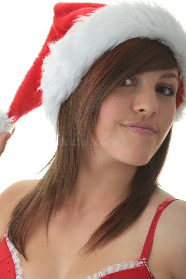 Femme de l'adolescence utilisant le chapeau de Santa photographie stock