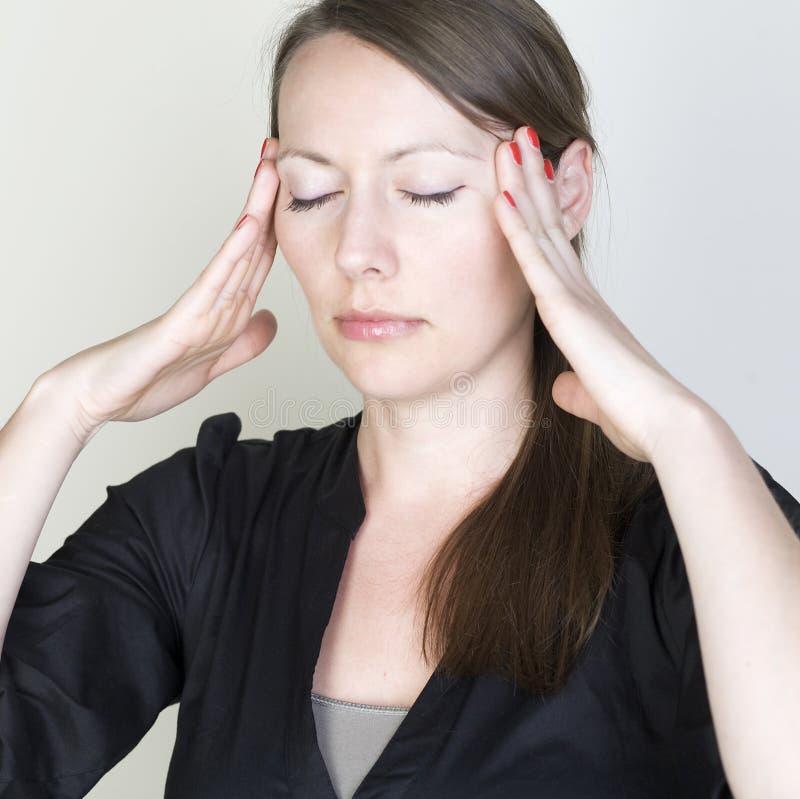 Femme de mal de tête images libres de droits