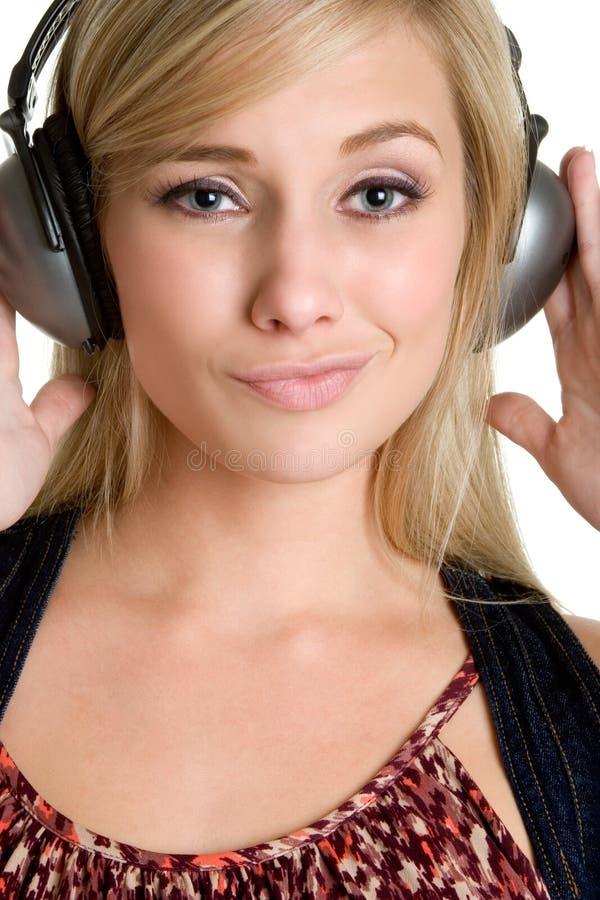 Femme de musique d'écouteurs photographie stock