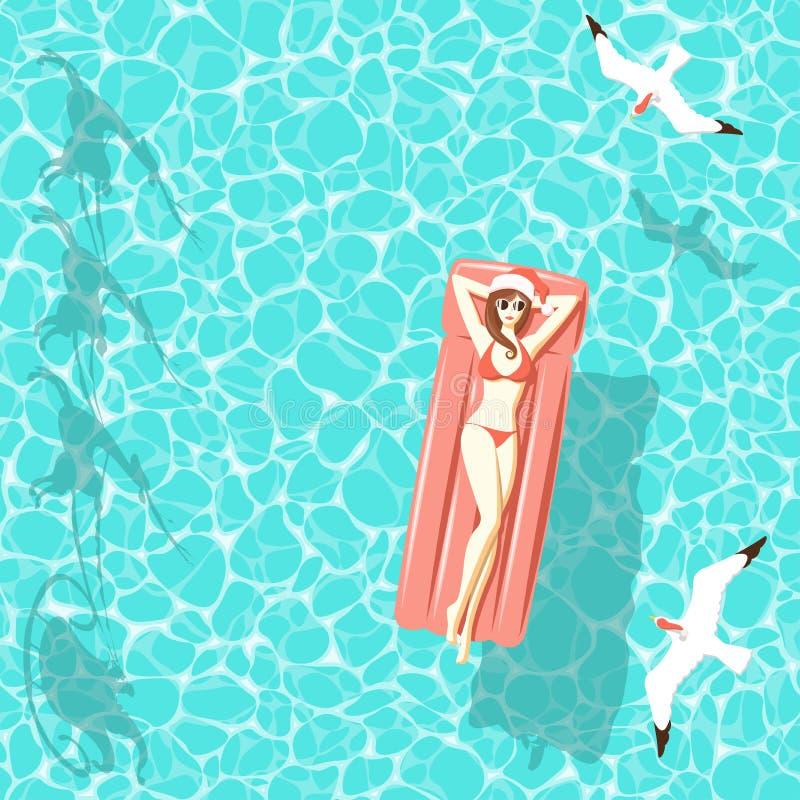 Femme de Noël sur le matelas d'air en mer illustration stock